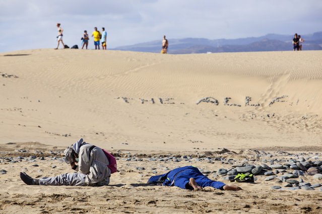 Two would-be immigrants rest at Maspalomas beach on Gran Canaria in Spain's Canary Islands. (Photo by Borja Suarez/Reuters)
