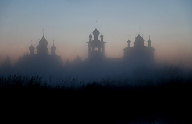 The Nikolo-Vyazhischsky Women's Monastery is seen through fog in the village of Vyazhishchi in Novgorod Region, Russia on July 14, 2020. (Photo by Anton Vaganov/Reuters)