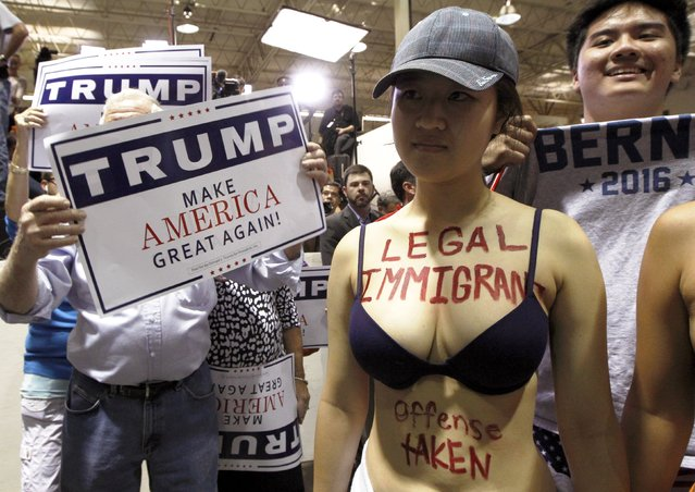 A protestor opposed to U.S. Republican presidential candidate Donald Trump's stance on immigration clashes with Trump supporters at a rally in Norcross, Georgia October 10, 2015. (Photo by Tami Chappell/Reuters)