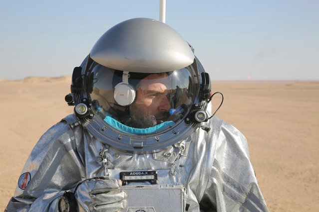 This February 7, 2018, photo shows João Lousada, a flight controller for the International Space Station, wearing an experimental space suit during a simulation of a future Mars mission in the Dhofar desert of southern Oman. (Photo by Sam McNeil/AP Photo)