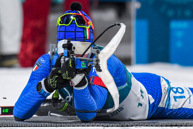 Italy's Lukas Hofer competes at the shooting range in the men' s 10 km sprint biathlon event during the Pyeongchang 2018 Winter Olympic Games on February 11, 2018, in Pyeongchang. (Photo by Francois-Xavier Marit/AFP Photo)