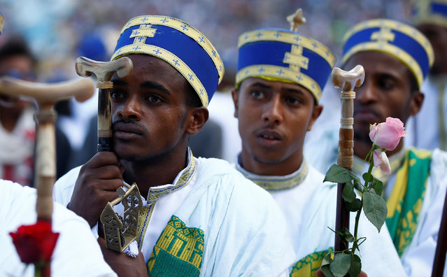 Deacons attend a praying session during the Meskel Festival to commemorate the discovery of the true cross on which Jesus Christ was crucified on, at the Meskel Square in Ethiopia's capital Addis Ababa, September 26, 2016. (Photo by Tiksa Negeri/Reuters)