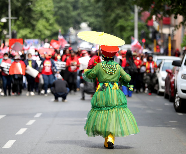 A Member of the Congress of South African Trade Unions (COSATU) joins other strikers as they take part in a nationwide strike over issues including corruption and job losses outside parliament in Johannesburg, South Africa, October 7, 2020. (Photo by Siphiwe Sibeko/Reuters)