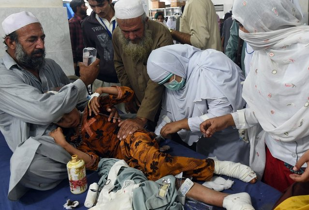 An injured girl is treated at a hospital in Peshawar, Pakistan, after an earthquake struck on October 26, 2015. (Photo by A. Majeed/AFP Photo)