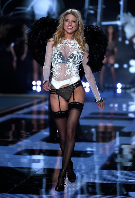 Model Martha Hunt walks the runway at the annual Victoria's Secret fashion show at Earls Court on December 2, 2014 in London, England. (Photo by Pascal Le Segretain/Getty Images)