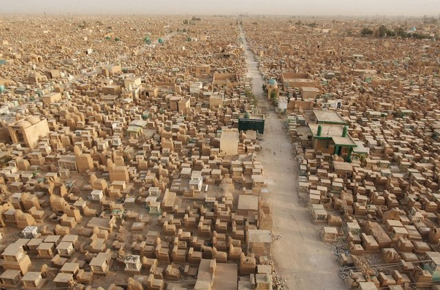 """The """"Valley of Peace"""" cemetery in Najaf, 160 km (100 miles) south of Baghdad, Iraq, is seen in this general view taken April 1, 2013. (Photo by Haider Ala/Reuters)"""