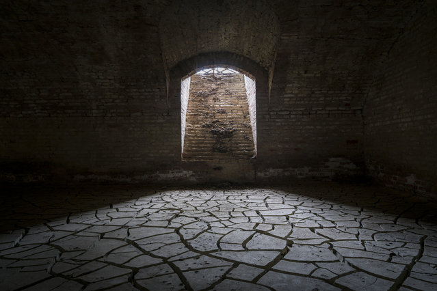 Shortlisted: Citadel of Alessandria, Italy. This was taken in the basement of the abandoned Citadel of Alessandria. Years ago, the river in the city flooded the basement of the complex. The floor as you see it in this photo is a remainder of that. It is dried mud. The Citadel of Alessandria was built by Carlo Emanuele III, the King of Sardinia, in 1732 and terminated by Napoleon in 1808. With its 74 hectares it represents one of the greatest examples of an 18th-century fortification with bastions in Europe and one of the few that exist today. (Photo by Roman Robroek/Historic Photographer of the Year 2020)