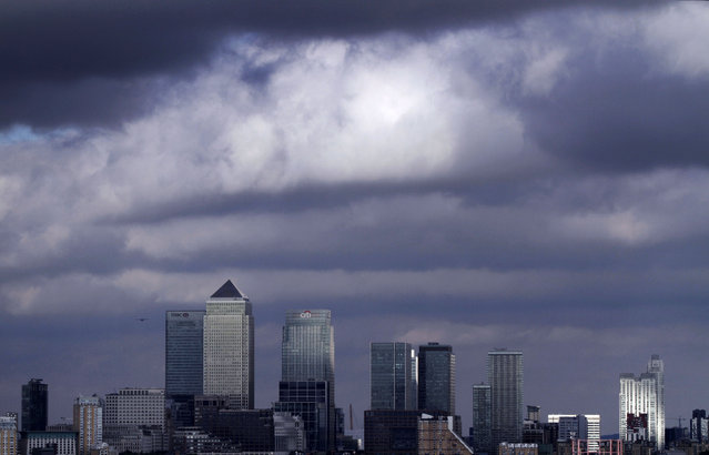 In this Tuesday, August 17, 2010 file photo, a view of the Canary Wharf financial district in London. A key adviser to the European Union's highest court is siding against Britain and wants the EU cap on bankers' bonuses to be maintained. (Photo by Lefteris Pitarakis/AP Photo)