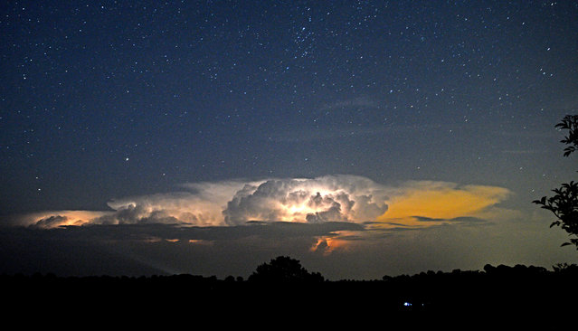 Spectacular lightning flashes illuminate the clouds over the hills of Herefordshire on August 11, 2020 near Craswall, as tropical temperatures hung over the UK again. (Photo by Chas Breton/Rex Features/Shutterstock)