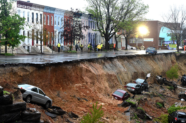 One lane of the East 26th Street between North Charles and North St. Paul streets collapsed about 4 p.m. and slid down an embankment leading to the tracks below washing away cars and flooding CSX railroad as a massive storm system drops heavy rains on the DC region with  on April 30,  2014 in Baltimore, MD. (Photo by Jonathan Newton/The Washington Post)