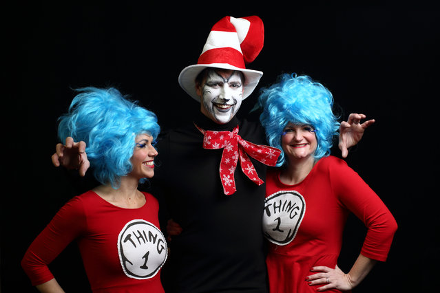 Darts fans Kelly Sutton (L), Gary Sutton (C) and Zoe Sutton (R) in fancy dress ahead Day Eight of the William Hill PDC World Darts Championships at Alexandra Palace on December 28, 2014 in London, England. (Photo by Jordan Mansfield/Getty Images)