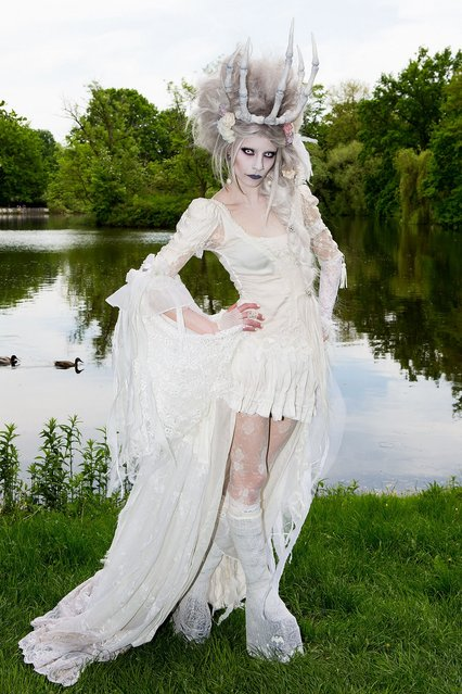 A girl in a vamire costume poses for pictures during the traditional park picnic on the first day of the annual Wave-Gotik Treffen, or Wave and Goth Festival, on May 17, 2013 in Leipzig, Germany. The four-day festival, in which elaborate fashion is a must, brings together over 20,000 Wave, Goth and steam punk enthusiasts from all over the world for concerts, readings, films, a Middle Ages market and workshops. (Photo by Marco Prosch)