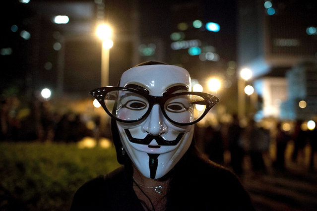 Hong Kong: A pro-democracy protester wears a Guy Fawkes mask on a street near Hong Kong Government Complex in Admiralty district on November 5, 2014 in Hong Kong. Pro-democracy protesters staged a rally on Guy Fawkes day. (Photo by Anthony Kwan/Getty Images)