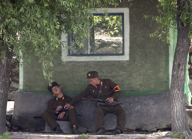 North Korean soldiers guard the bank of Yalu River near the North Korean town of Sinuiju, opposite the Chinese border city of Dandong, July 3, 2009. (Photo by Jacky Chen/Reuters)