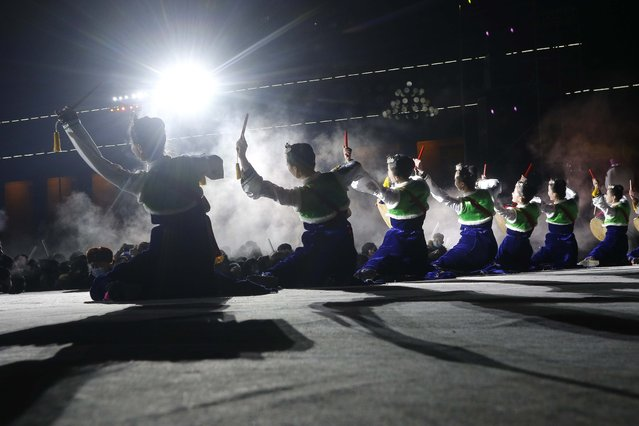 Performers entertain the gathered crowds during celebrations to mark the New Year, at Kim Il Sung Square in Pyongyang, North Korea, early Friday, January 1, 2021. (Photo by Jon Chol Jin/AP Photo)
