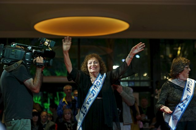 Linda Ruben, 82, (C) a Holocaust survivor, walks on a runway during a beauty contest for survivors of the Nazi genocide in the northern Israeli city of Haifa November 24, 2015. (Photo by Amir Cohen/Reuters)