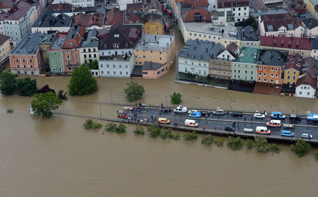 An aerial view of the overflooded Germany city of Passau on June 3, 2013. (Photo by Peter Kneffel/AFP Photo)