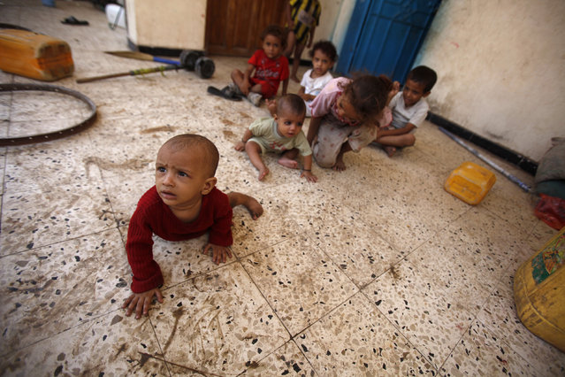 Children play at a school sheltering them in the southern Yemeni port city of Aden October 8, 2012. (Photo by Khaled Abdullah/Reuters)