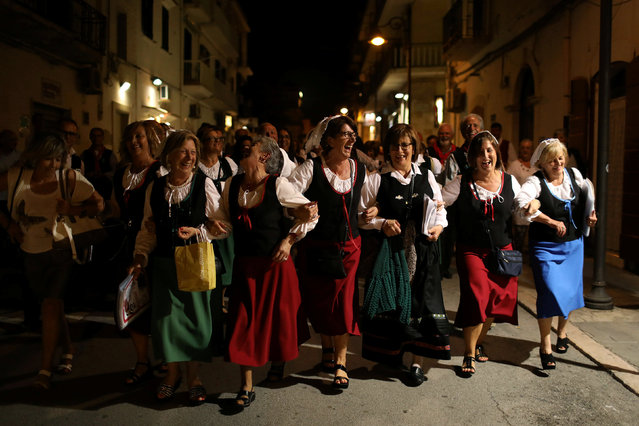 A folklore choir group from the town of Castel del Monte in Abruzzo performs in the town of Vieste in the province of Foggia, Puglia, Italy, September 17, 2016. (Photo by Siegfried Modola/Reuters)