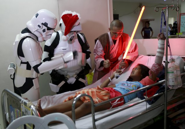 Cosplayers dressed as characters from the Star Wars movie series visit patients during a charity event organised by non-profit group 501st Legion, at East Avenue Medical Center in Quezon city, metro Manila  December 6, 2015. (Photo by Romeo Ranoco/Reuters)