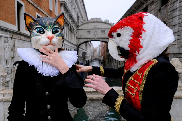 People wear carnival masks by the Bridge of Sighs to celebrate Venice's annual colourful carnival, which has been cancelled this year due to the coronavirus disease (COVID-19) pandemic, in Venice, Italy, February 7, 2021. (Photo by Manuel Silvestri/Reuters)