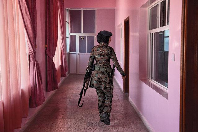 A lieutenant in an elite female counterterrorism unit patrols the women's barracks in Yemen, 2012. (Photo by Stephanie Sinclair/National Geographic)
