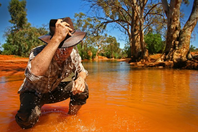 """Wet"". A swollen creek bed in the desert near Broken Hill in Australia a local cools off. (Photo and caption by Miles Rowland/National Geographic Traveler Photo Contest)"
