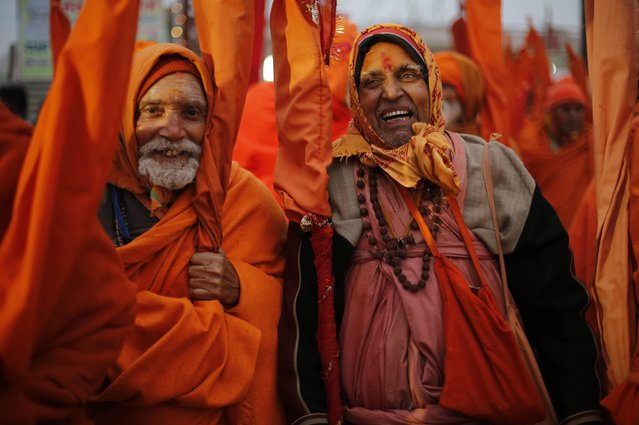 Indian Sadhus, or Hindu holy men, participate in a community feast at the Sangam, the confluence of the Rivers Ganges, Yamuna and mythical Saraswati, during the annual month-long Magh Mela religious fair in Allahabad, India, Friday, January 16, 2015. (Photo by Rajesh Kumar Singh/AP Photo)