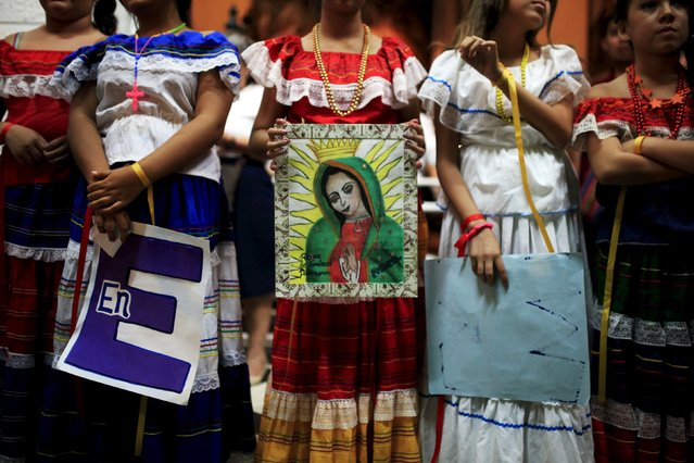 Girls participate in a ceremony to celebrate the Day of the Virgin of Guadalupe inside the Basilica of Guadalupe in San Salvador, El Salvador December 11, 2015. (Photo by Jose Cabezas/Reuters)