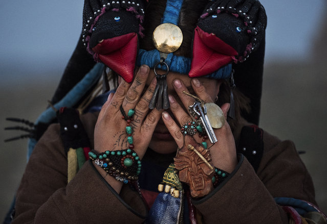 A Mongolian Shaman or Buu, prays during a sun ritual ceremony to mark the period of the Summer Solstice in the grasslands at sunrise on June 22, 2018 outside Ulaanbaatar, Mongolia. (Photo by Kevin Frayer/Getty Images)