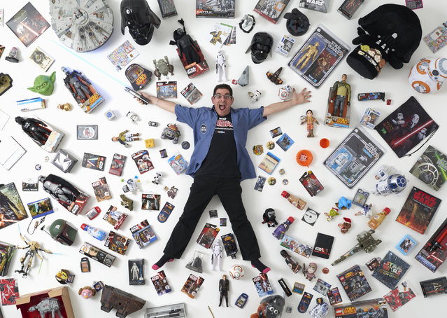 "Star Wars collector James Burns, 44, poses for a photograph with some of his collection in London December 2, 2015. He said ""I've met so many wonderful people, all over the world. It's a wonderful community of likeminded people with an interest in Star Wars. There's nothing else like it"". (Photo by Paul Hackett/Reuters)"