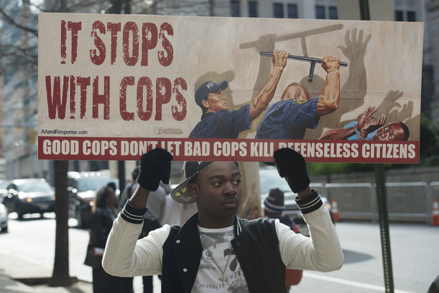 Melvin Townes is one of a small handful of protesters gathered outside the Baltimore City Circuit County Court as the jury deliberates on day three of the trial Baltimore officer William G. Porter accused of involuntary manslaughter in Baltimore, Maryland on December 16, 2015. (Photo by Marvin Joseph/The Washington Post)