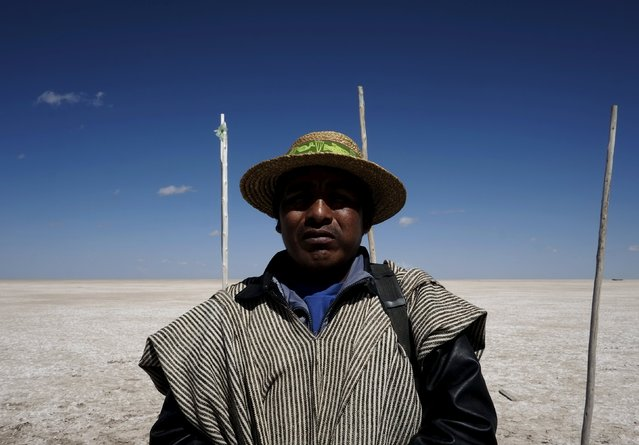 Fisherman Rene Valero, from the Urus ethnic group, is seen at the dried Poopo lakebed in the Oruro Department, south of La Paz, Bolivia, December 17, 2015. (Photo by David Mercado/Reuters)