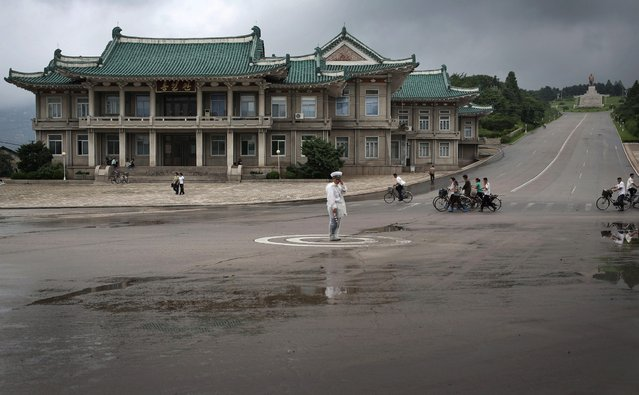 A North Korean traffic policeman carries out his duties on Monday, July 22, 2013 in  Kaesong, North Korea. (Photo by Wong Maye-E/AP Photo)