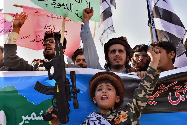Activists of the banned Pakistani charity organisation, Jamaat-ud-Dawa (JuD) shout slogans during a protest to mark Kashmir Solidarity day in Peshawar on February 5, 2015. Pakistan observed Kashmir Solidarity Day on February 5 to denounce Indian rule in the disputed Himalayan region claimed in whole by both countries. (Photo by A. Majeed/AFP Photo)