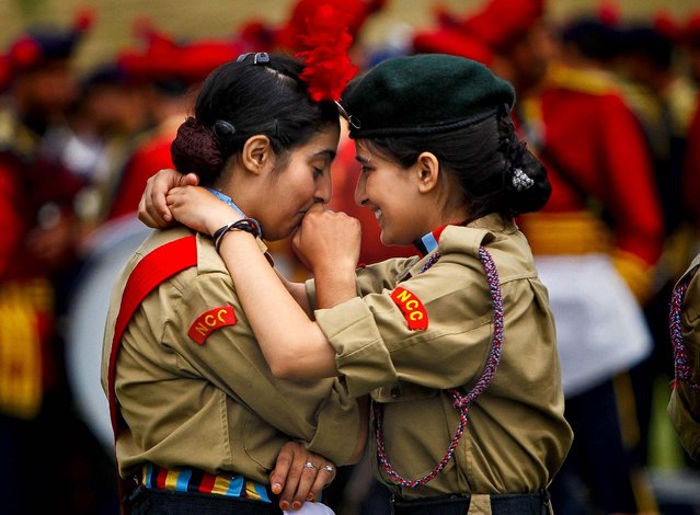 National Cadet Corps  members embrace during during a dress rehearsal for India's Independence Day celebrations in Srinagar, on August 13, 2013. (Photo by Danish Ismail/Reuters)