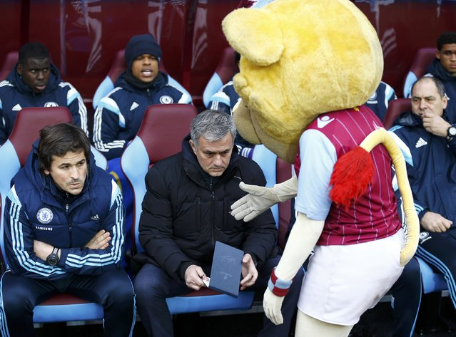 Chelsea manager Jose Mourinho reacts as the Aston Villa mascot extends his hand towards him before their English Premier League soccer match at Villa Park, Birmingham, February 7, 2015. (Photo by Darren Staples/Reuters)