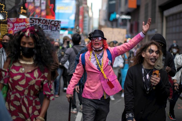People march through Times Square during a Stop Asian Hate rally in New York City, U.S., April 4, 2021. (Photo by Eduardo Munoz/Reuters)