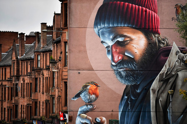 A view of one of the latest murals near Glasgow cathedral on October 26, 2016 in Glasgow, Scotland. The murals have been appearing across the city for a since 2008 with new ones appearing on a regular bases rejuvenating bare walls revitalising tired corners of Glasgow. Now a new Mural Trail has been devised with a huge range of them on display within a short walking distance from the city centre. (Photo by Jeff J. Mitchell/Getty Images)
