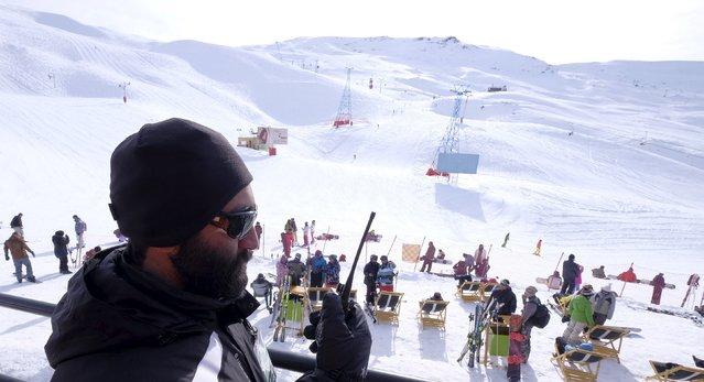 An Iranian security man talks on a walkie-talkie at the Dizin ski resort, northwest of Tehran January 15, 2016. (Photo by Raheb Homavandi/Reuters/TIMA)