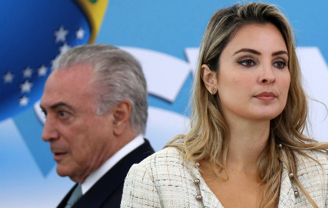 Brazil's President Michel Temer and his wife Marcela attend a ceremony at Planalto Palace in Brasilia, Brazil December 7, 2016. (Photo by Adriano Machado/Reuters)