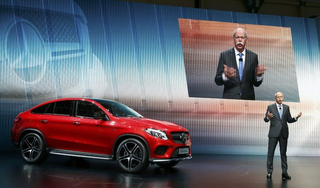 Daimler CEO Dieter Zetsche presents the new Mercedes GLE 450 AMG Coupe during the first press day ahead of the 85th International Motor Show in Geneva March 3, 2015. REUTERS/Arnd Wiegmann