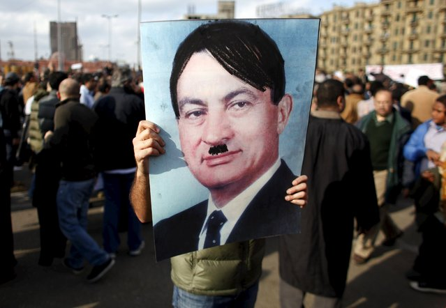 A man carries a picture depicting Egyptian President Hosni Mubarak as Adolf Hitler during a protest in Cairo January 31, 2011. (Photo by Goran Tomasevic/Reuters)