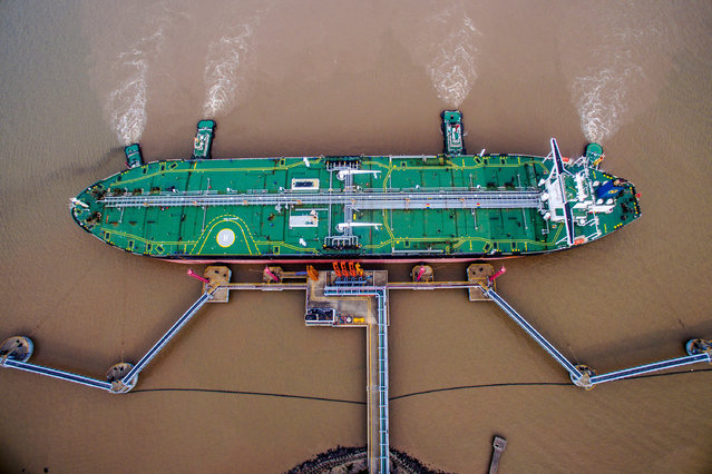 An oil tanker unloads crude oil at a crude oil terminal in Zhoushan, Zhejiang province, China July 4, 2018. (Photo by Reuters/China Stringer Network)