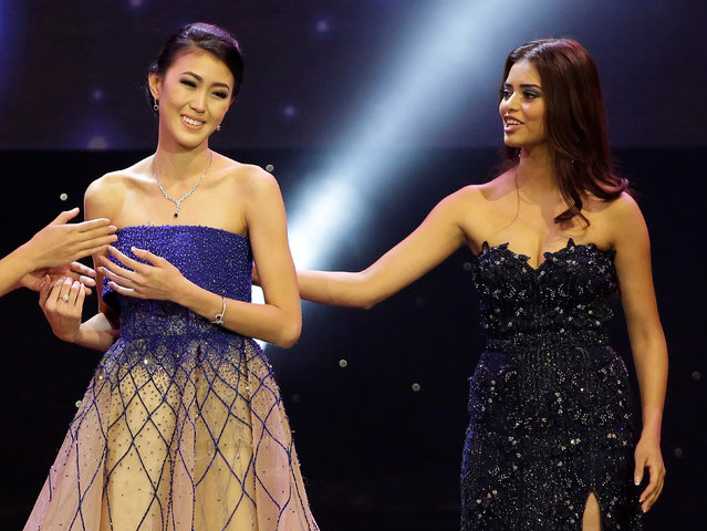 Miss Indonesia Natasha Mannuela (L) is congratulated by Miss India Priyadarshini Chatterjee after winning the Beauty with a Purpose prize during the Miss World 2016 Competition in Oxen Hill, Maryland, U.S., December 18, 2016. (Photo by Joshua Roberts/Reuters)