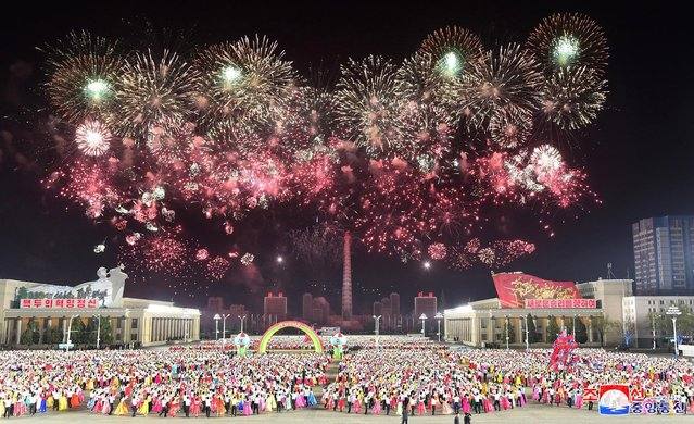 This picture taken on April 15, 2021 released from North Korea's official Korean Central News Agency (KCNA) on April 16 shows an evening party for young students celebrating the birthday of their country's founder and Eternal President Kim Il Sung, at Kim Il Sung Square in Pyongyang. (Photo by KCNA via KNS/AFP Photo)