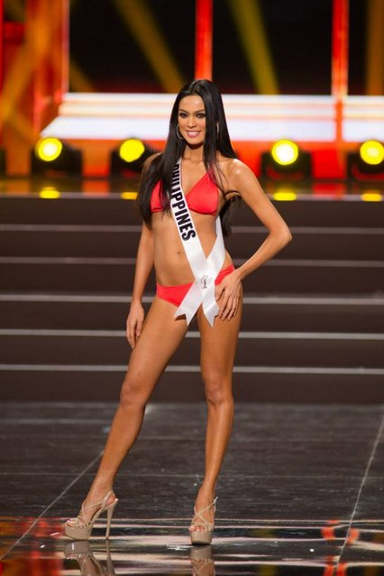 This photo provided by the Miss Universe Organization shows Ariella Arida, Miss Philippines 2013, competes in the swimsuit competition during the Preliminary Competition at Crocus City Hall, Moscow, on November 5, 2013. (Photo by Darren Decker/AFP Photo)