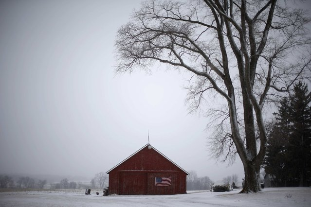 A U.S. flag hangs from a barn in Solon, Iowa, January 25, 2015. (Photo by Jim Young/Reuters)