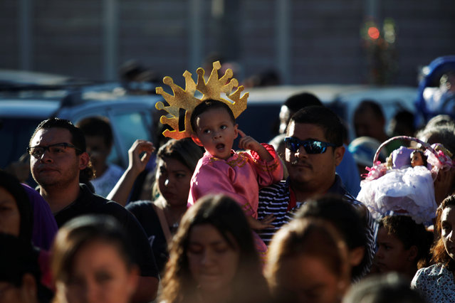 A child dressed as baby Jesus participates in a religious procession on Holy Innocents Day in Antiguo Cuscatlan, El Salvador, December 28, 2016. (Photo by Jose Cabezas/Reuters)