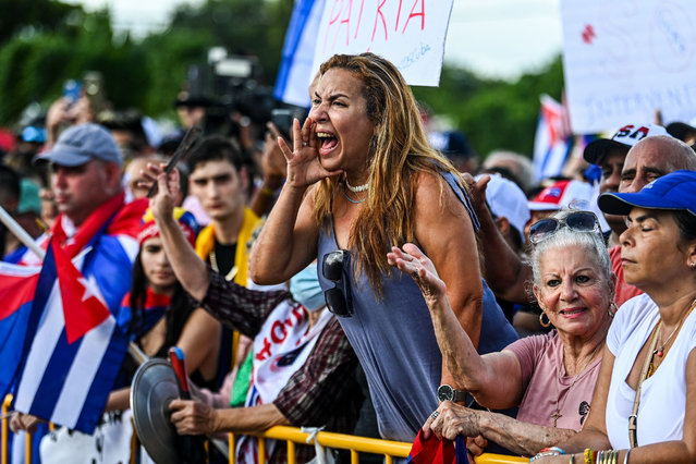 Naima Pineda shouts slogans as she protests to show support for Cubans demonstrating against their government, in Miami, on July 14, 2021. One person has died and more than 100 were arrested, including independent journalists and opposition activists, since the anti-government protests broke out in the communist-ruled island over the worst economic crisis in decades. (Photo by Chandan Khanna/AFP Photo)